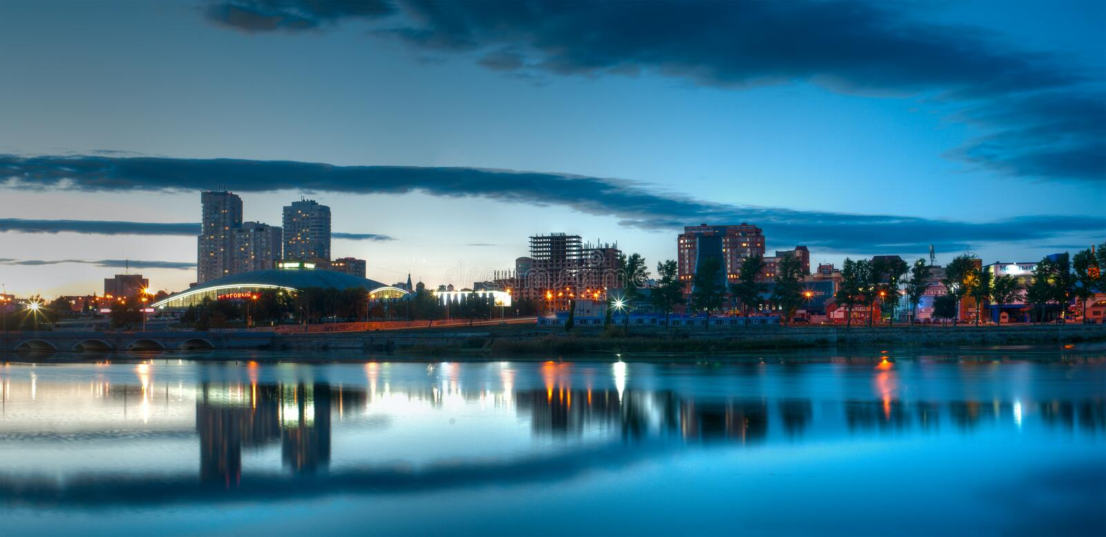 Evening panorama of the Miass River embankment, Chelyabinsk, September 2017. Editorial use only. On the banks of the Miass River there are the Shopping Center royalty free stock images