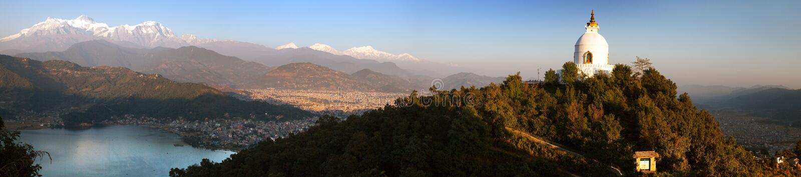 Annapurna, Manaslu, world peace stupa, Pokhara. Evening panoramic view of world peace stupa, Phewa lake, Pokhara and great himalayan range, mount Annapurna royalty free stock images