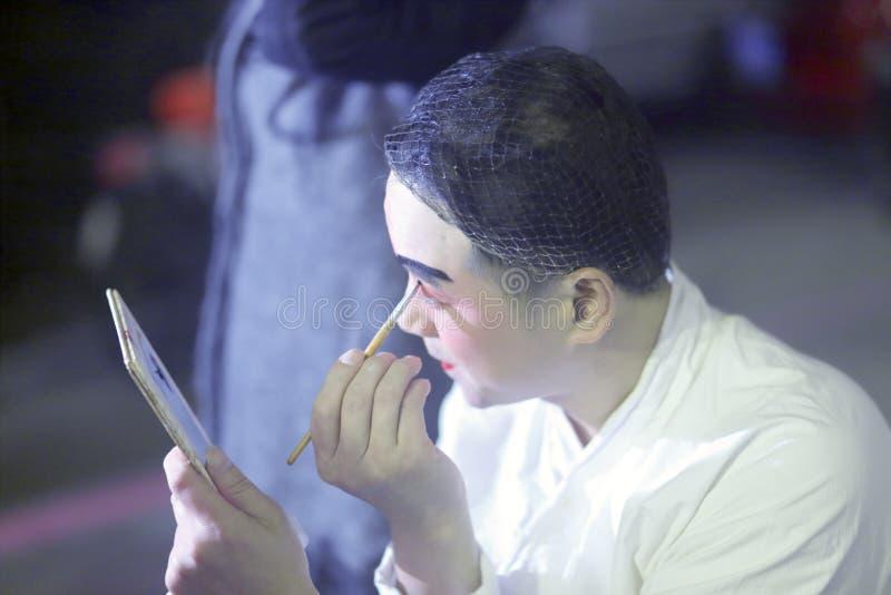 Evening performance beijing opera actor make-up. Before the open-air performances, folk opera actor makeup, xiamen city, china royalty free stock photos