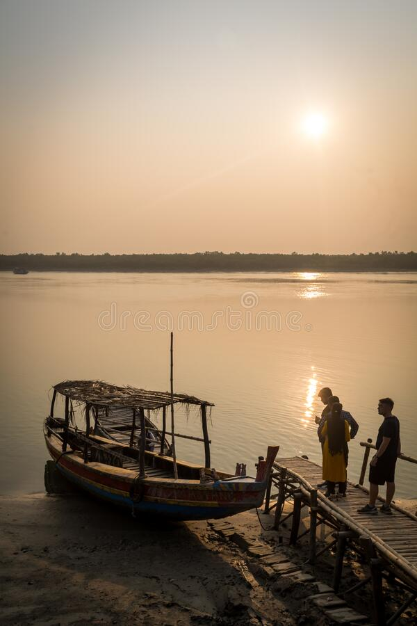 Evening ride, Sundarban, India. Sundarban, West Bengal, India : January 22, 2020 : Tourists waiting for boarding a small motor boat before a evening ride on the royalty free stock photography