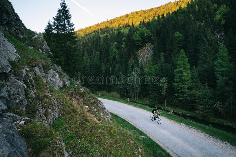 evening on road bicycle in mountains stock photo