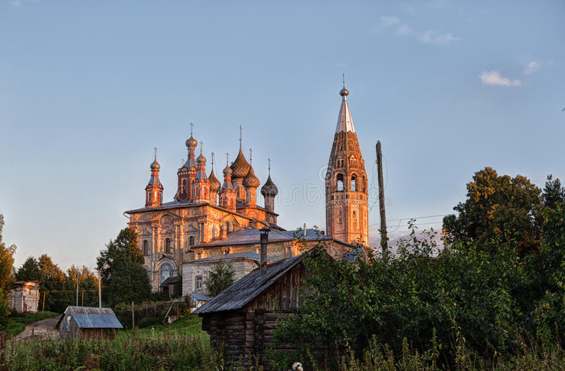 Evening rural landscape with old church stock photos