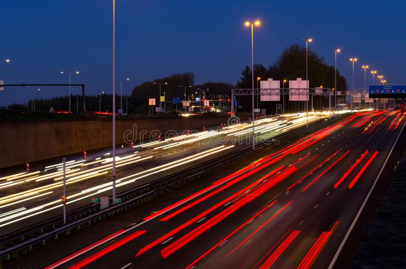 Evening rush hour on the motorway at the Gouwe aquaduct. A12, Gouda in the Netherlands. Long shutter/exposure speed image stock photo