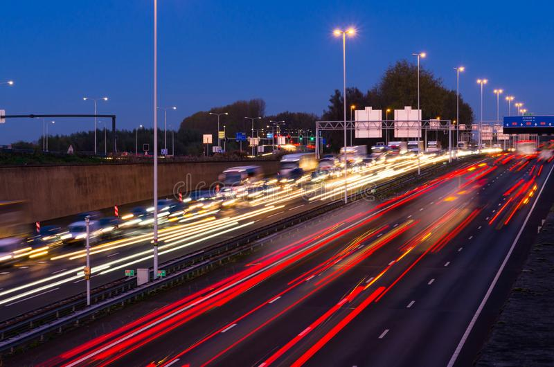 Evening rush hour on the motorway near the Gouwe aquaduct A12 in the Netherlands. Evening rush hour on the motorway near the Gouwe aquaduct A12, Gouda in the stock images