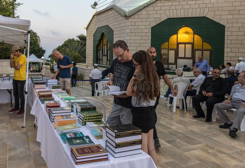 Evening sale of holy books about Islam in the courtyard of the Ahmadiyya Shaykh Mahmud mosque in Haifa city in Israel. Haifa, Israel, July 11, 2019 : Evening royalty free stock image