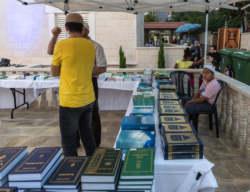 Evening sale of holy books about Islam in the courtyard of the Ahmadiyya Shaykh Mahmud mosque in Haifa city in Israel. Haifa, Israel, July 11, 2019 : Evening royalty free stock photos
