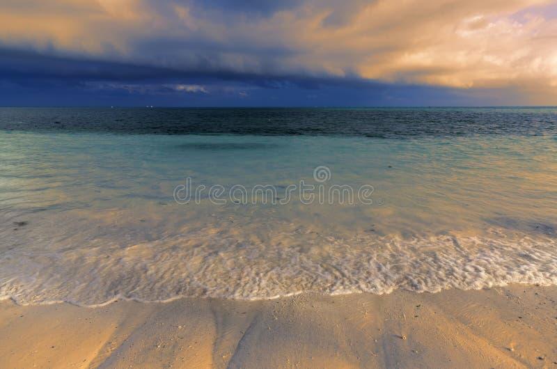 Evening scene on ocean shore stock image