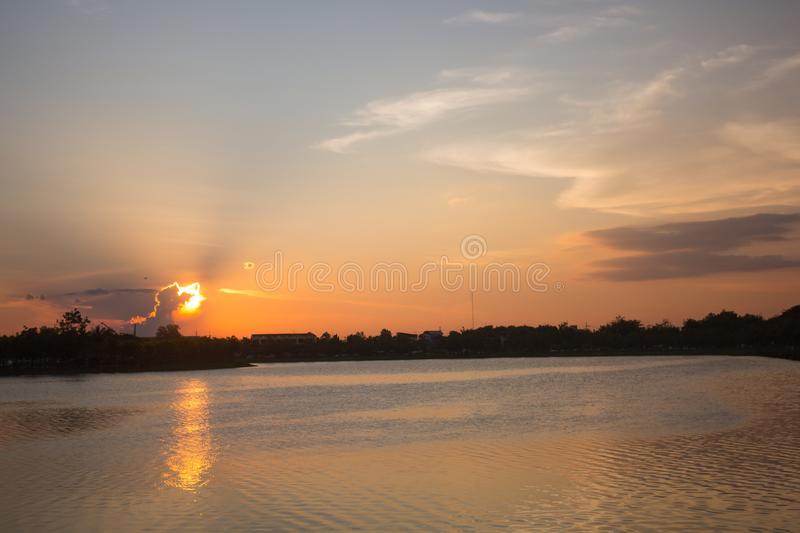 Evening scene over lake water,Thailand royalty free stock photography