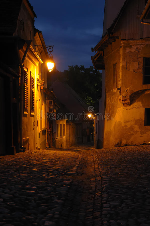 Evening scene in Transylvania, Romania. A typical evening scene at the old historic town of Sighisoara, Transylvania, Romania royalty free stock image