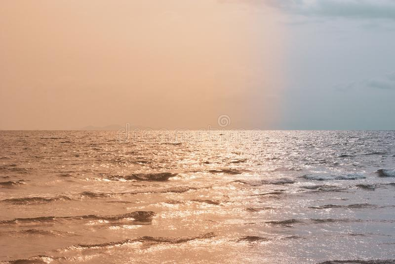 Evening sea atmosphere divided by two color tones which are oran stock photos