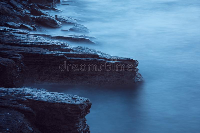 Evening sea long time exposure. Foggy water stock photo