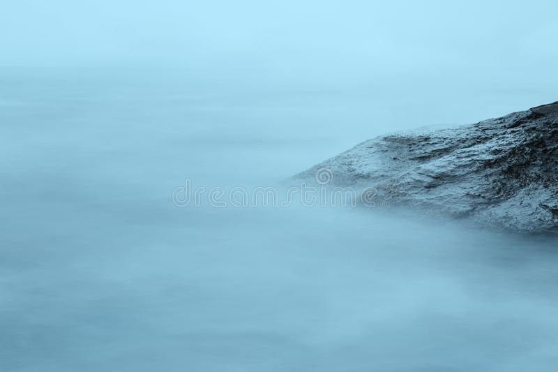 Evening sea long time exposure. Foggy water royalty free stock photo