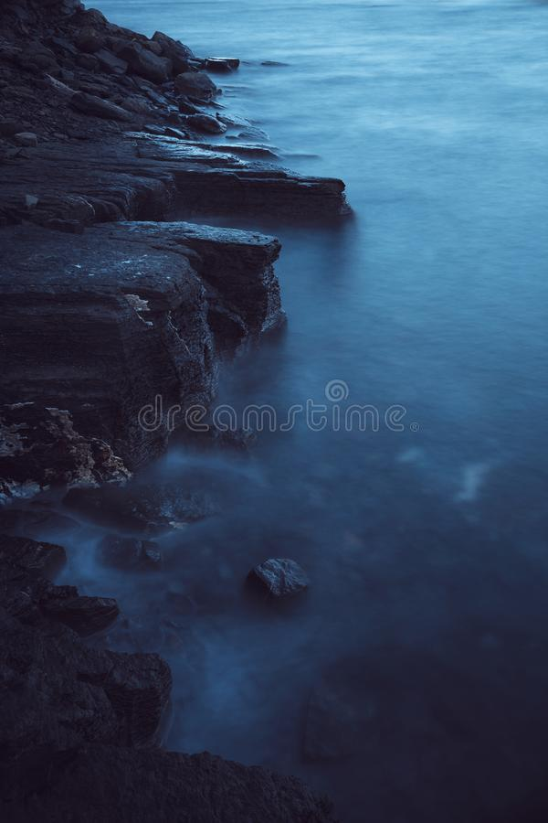 Evening sea long time exposure. Foggy water royalty free stock images
