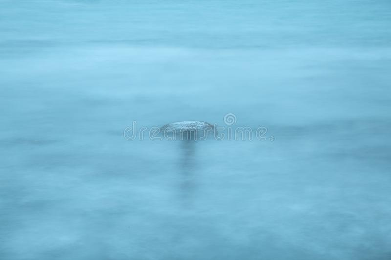 Evening sea long time exposure. Foggy water stock image