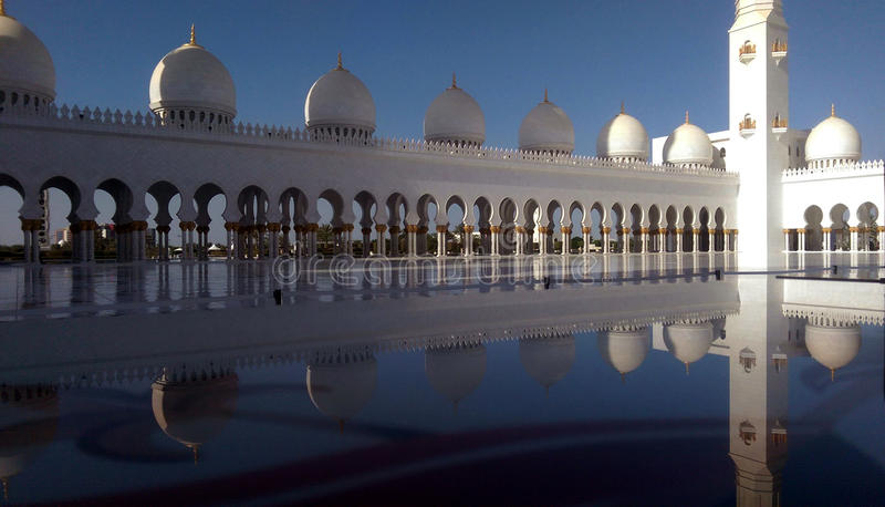 An evening in Sheikh Zayed Grand Mosque Abu Dhabi. Reflection of the Sheikh Zayed Grand Mosque Abu Dhabi Qubba in a Glass piece royalty free stock photography