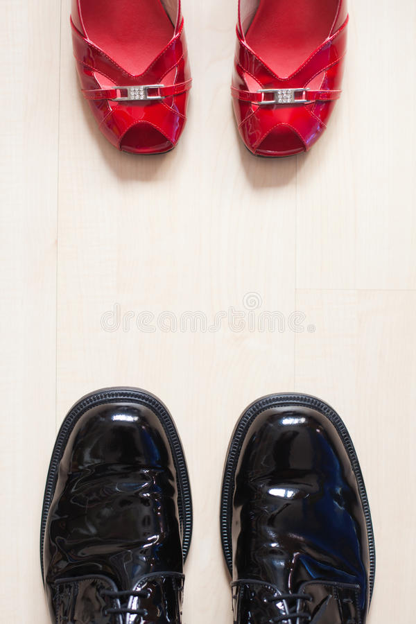 Evening shoes. From a couple are standing opposite on a laminate floor stock photos