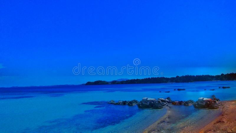 Evening shot of beach in Greece stock images