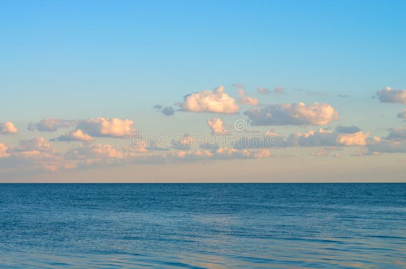 Evening sky with clouds on the sea. horizon. Beautiful landscape royalty free stock photos