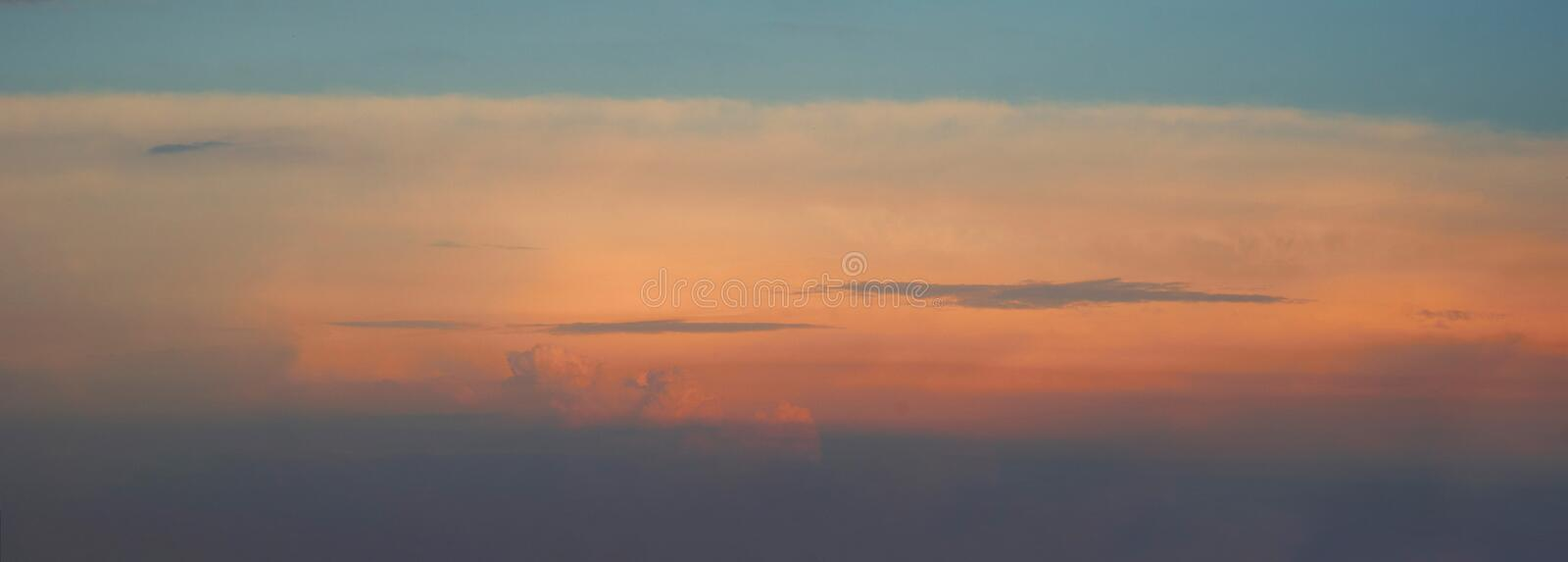 Evening sky with clouds in soft colors. Orange sky. Sunset royalty free stock images