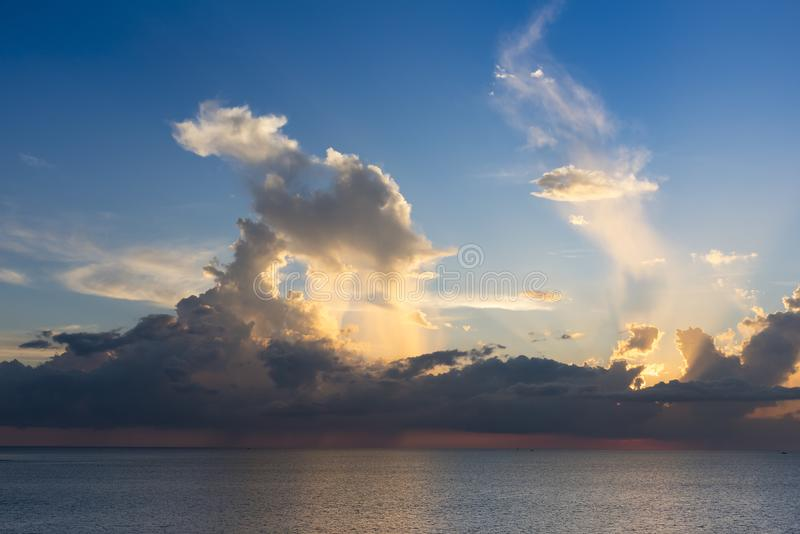 Evening sky with dramatic clouds over the sea with sculpted 3D cloudscape. And striking light to make a background image royalty free stock photo
