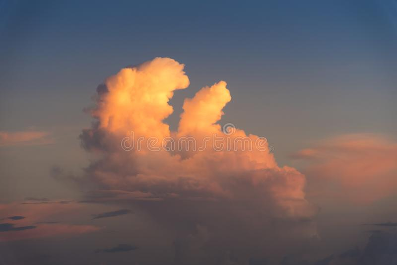Evening sky with dramatic clouds over the sea with sculpted 3D cloudscape. Striking light for a photogenic background stock images