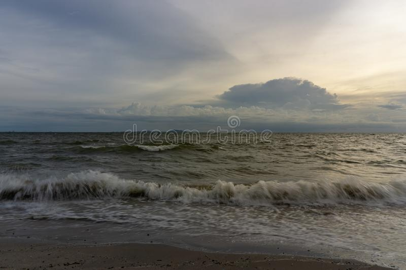 The evening sky has clouds full of sky, the light from the sun reflect Seawater, sea surface.  stock photo