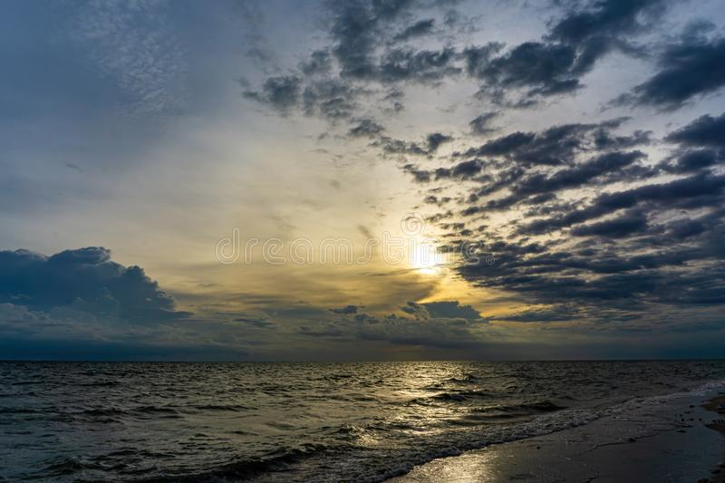 The evening sky has clouds full of sky, the light from the sun reflect Seawater, sea surface.  stock image