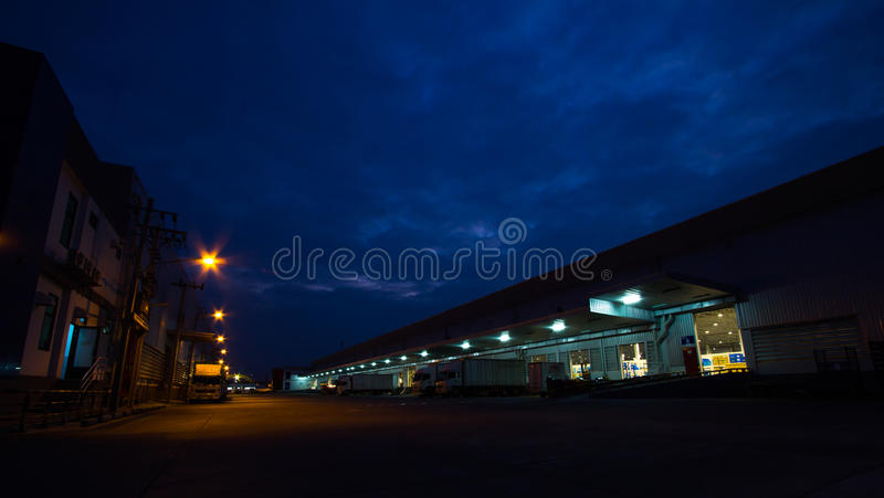 Evening sky and light warehouse area.  royalty free stock images