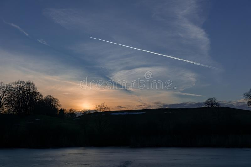 Evening sky over a frozen pond in Germany stock photos