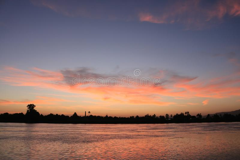 Sun set over the River Nile in Luxor Egypt stock photography