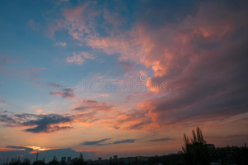 Evening sky at sunset with beautiful clouds over the city stock images