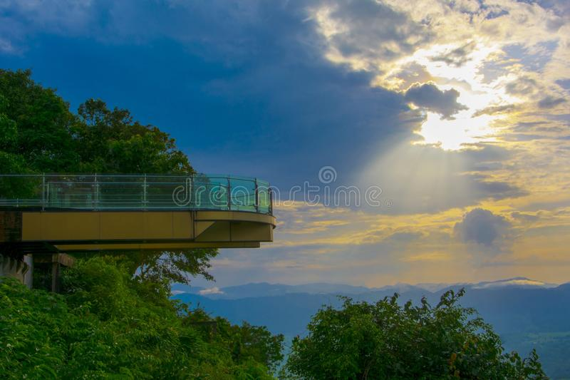 Sunset Sky View through Skywalk at Wat Pha Tak Sue Nong Khai Province Thailand. The evening skyline of dark, dark shadows with evening sunlight shines on Skywalk stock image