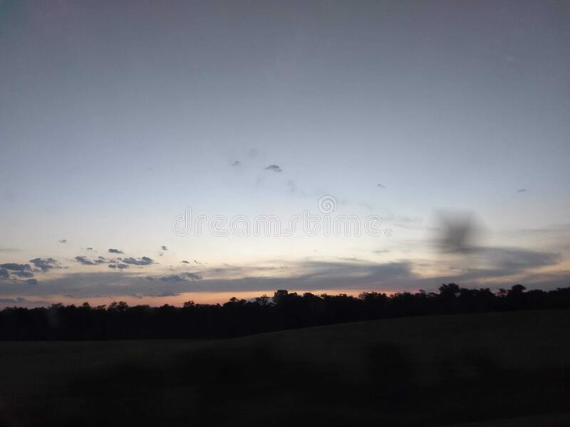 evening Skyline in field royalty free stock photography
