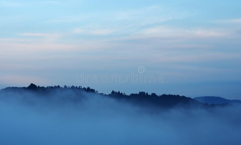 Evening skyline and misty valley stock photography