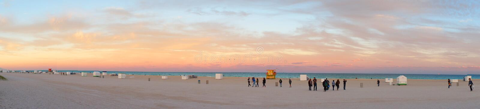 Evening South Beach of Miami near Atlantic Ocean. Miami Beach, United States - February 12, 2016: People walk and relax at the evening South Beach of Miami near stock images