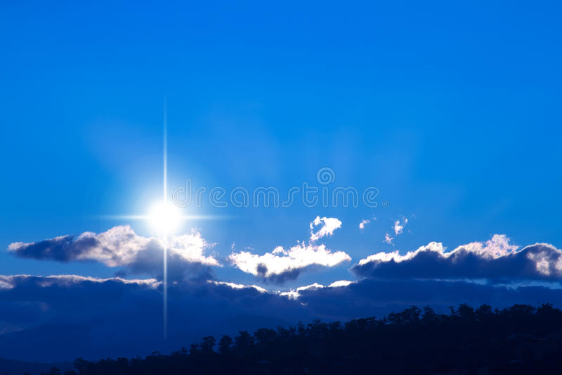 Evening star. Bright evening star on background of sunset blues in the mountains stock photo