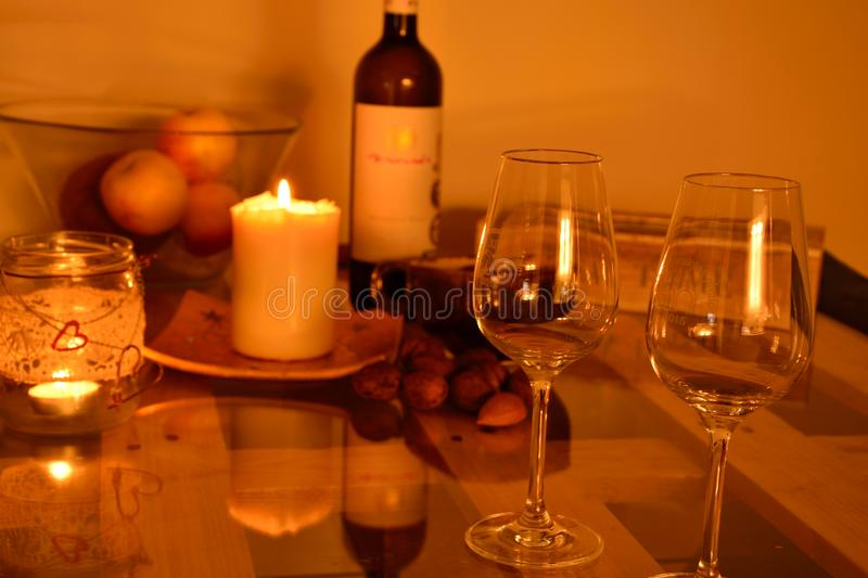 Evening still life with wine and candles royalty free stock photos