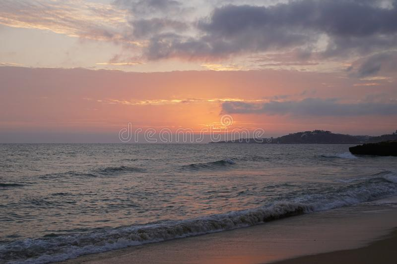 Evening sun over the ocean. Skies in the rays of salty light. Bright orange sunset royalty free stock photo
