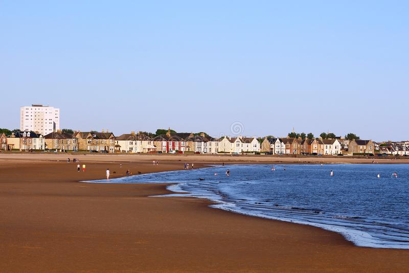 Evening sun on a sandy beach at Ardrossan Ayrshire royalty free stock photos