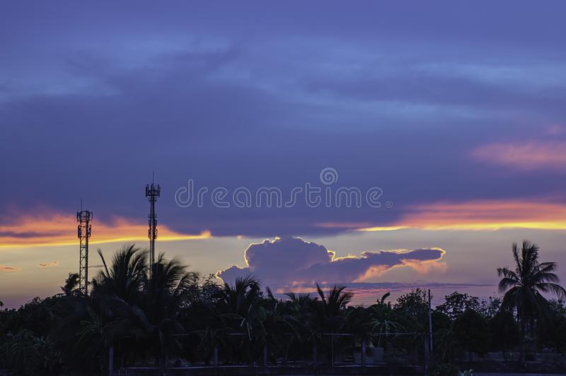 Evening sunset light is orange after the telephone receiver antenna.  stock images