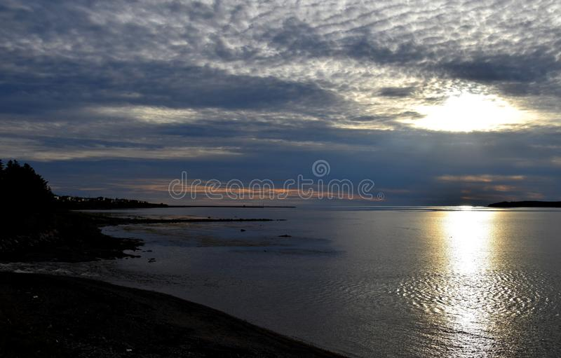 Evening sunset light over the ocean royalty free stock photography