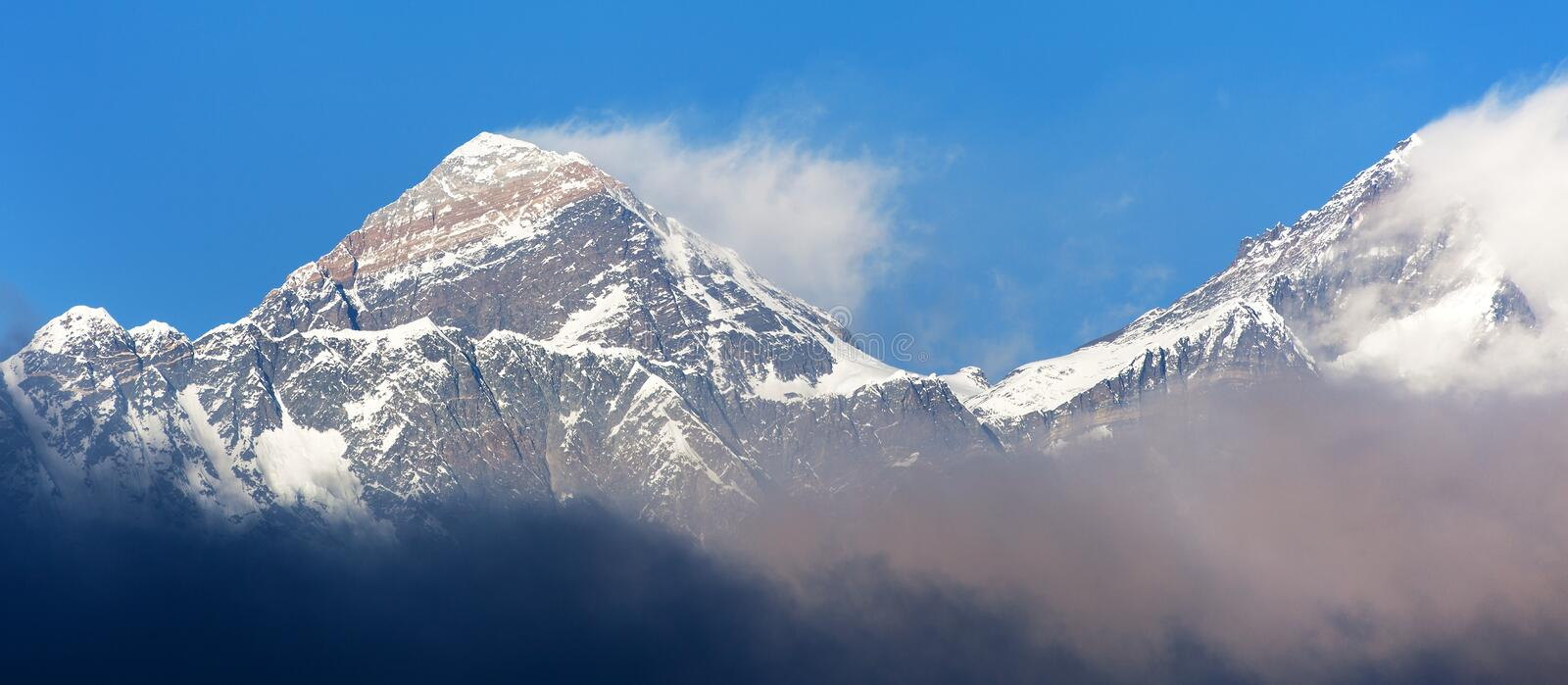 Evening sunset red colored view of Everest and Lhotse with beautiful clouds from Kongde village, Khumbu valley, Solukhumbu, Nepal royalty free stock photography
