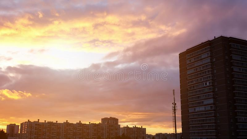 Evening sunset skyline cityscape with clouds stock photography