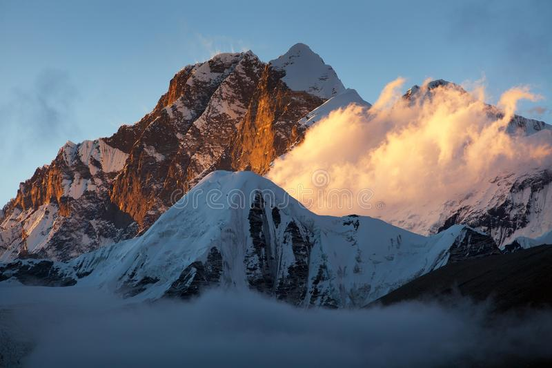 Evening sunset view of Mount Everest and Lhotse. Evening sunset view of Mount Everest Lhotse and Lhotse Shar from Makalu Barun valley, Nepal Himalayas mountains royalty free stock photo