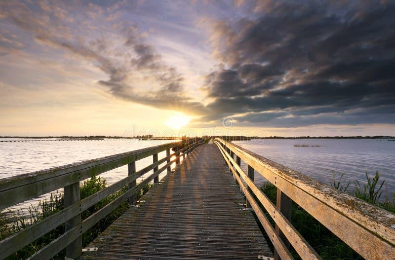 Evening sunshine over wooden bridge stock photography