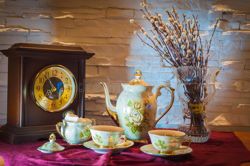 Evening tea Siberia Russia old watches Cup royalty free stock photography