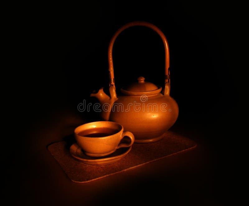 Evening tea still-life. Dark background royalty free stock images