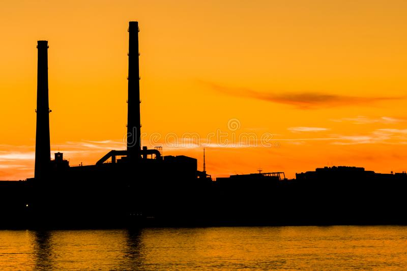 The evening thermal power station on the Neva river embankment in Saint Petersburg, Russia stock photos