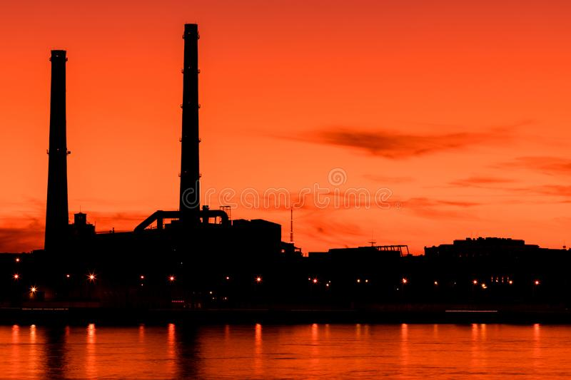 The evening thermal power station on the Neva river embankment in Saint Petersburg, Russia stock photo