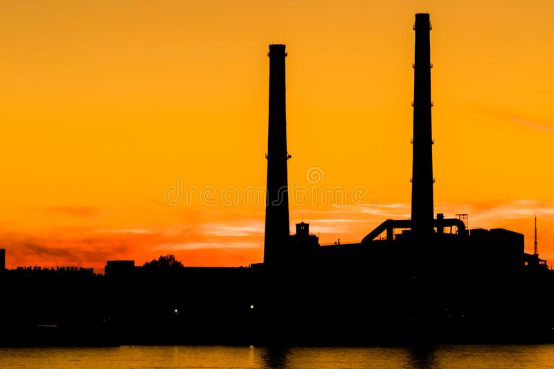 The evening thermal power station on the Neva river embankment in Saint Petersburg, Russia royalty free stock photos